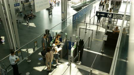 boletim : Basel, Switzerland - Circa 2017: Group of friends tourists commuters people men and women using the ePassport gates at airport border control in the EuroAirport Basel Mulhouse Freiburg for ticket passport id scan aerial above  documentary editorial report Stock Footage