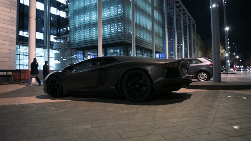 car logo : LONDON, UNITED KINGDOM - CIRCA 2017: Unique luxury supercar parked in front of the Science & Society Picture Library on 64 Exhibition Rd, Kensington London. Lamborghini Aventador is a mid-engine sports car produced by the Italian manufacturer Lamborghini.