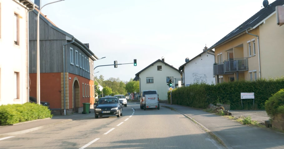 realtime : KEHL, GERMANY - CIRCA 2017: Driver point of view while driving calm on the urban roads of Kehl, in  Baden-Wurttemberg, Germany