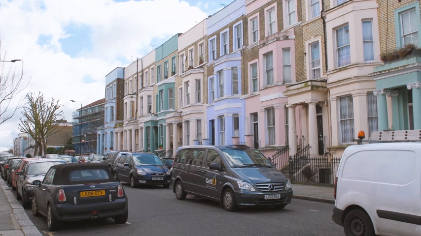 portobello road : LONDON, UNITED KINGDOM - CIRCA 2017: Colorful houses in Notting Hill street district in London, not so far from Portobello market on a warm summer day with cars parked nearby