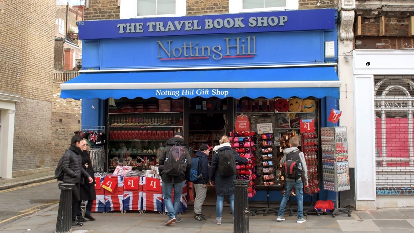 souvenirs : London, United Kingdom - Circa 2017: Famous Portobello market road in Notting hill London early in the morning with locals and tourists sightseeing with the Famous Gift Shop buying souvenirs