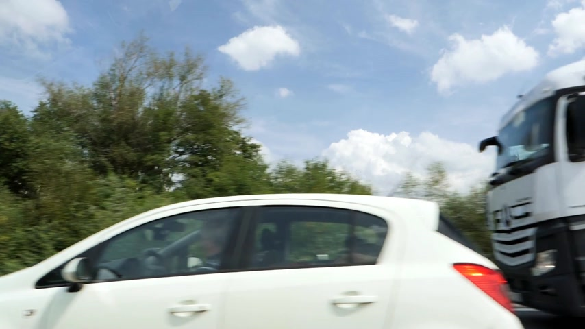 przesyłka : Bremen, Germany - Circa 2017: Busy German autobahn with DHL delivery truck transporting letters and parcels driving slow motion on warm summer day in Nord Germany Wideo