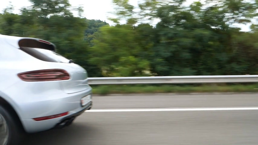 tuned : Zurich Switzerland - Circa 2017: White luxury Porsche Cayenne SUV driving on autobahn highway on a warm summer day