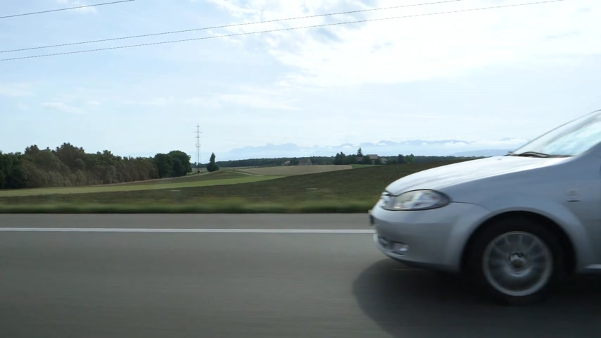 tuned : Zurich Switzerland - Circa 2017: White Chevrolet small car driving in slow motion on autobahn highway on a warm summer day Stock Footage