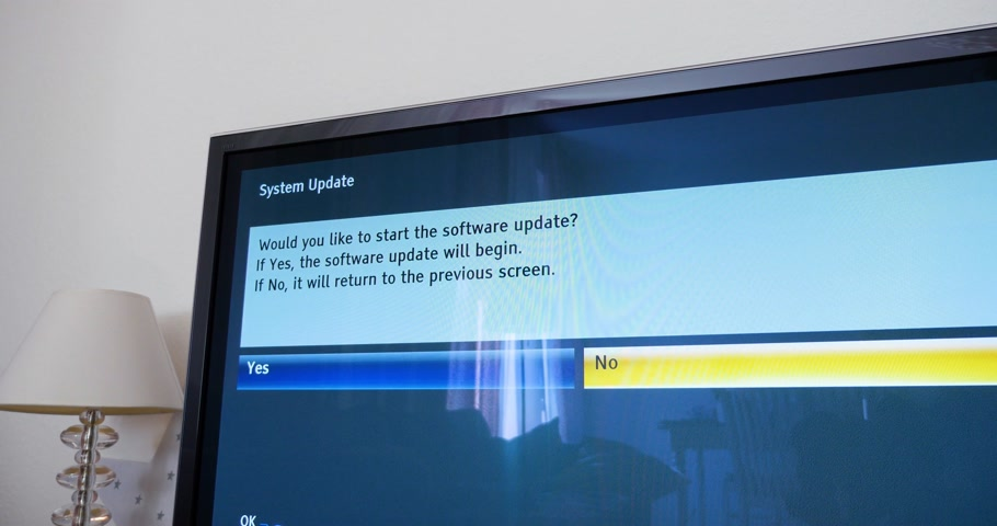 mevcut : London, United Kingdom - Circa 2017: Would you like to start the software process message on a new Panasonic Viera tv set in modern living room