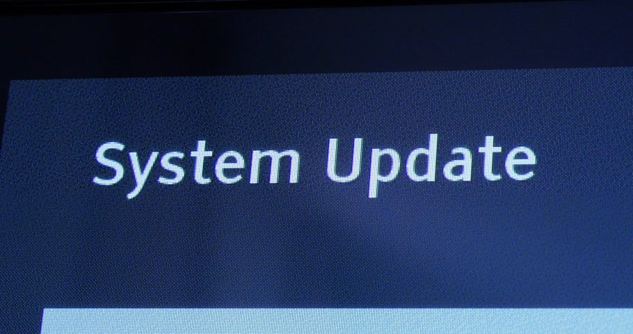 atualizar : LONDON, UNITED KINGDOM - CIRCA 2017: Zoom out from Panasonic Viera message of system update software process on a modern television set in living room with message System software is now updating, please wait. Please do not switch off your tv. Vídeos