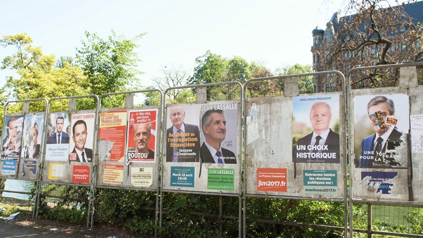 french president : STRASBOURG, FRANCE - APR 23, 2017: French presidential posters for the upcoming presidential election in France, in front of the City Hall building in Strasbourg Stock Footage