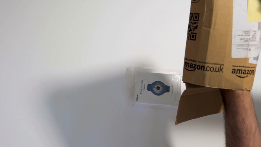 sealed : PARIS, FRANCE - CIRCA 2017, man unboxing new parcel from Amazon prime containing smartwatch activity and sleep tracker made by Nokia Health (Withings)