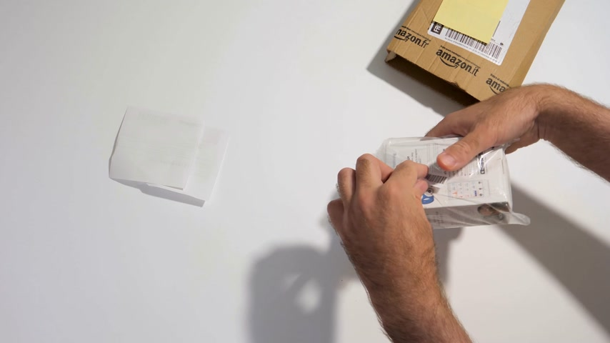 anglia : PARIS, FRANCE - CIRCA 2017, man point of view of unboxing process of  new parcel from Amazon prime containing smartwatch activity and sleep tracker made by Nokia Health (Withings)