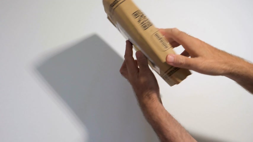 sealed : PARIS, FRANCE - CIRCA 2017, man unboxing new parcel from Amazon prime with Caution Warning information about Lithium Metal battery content - buying new smartphone and gadget from Amazon Online retailer Stock Footage