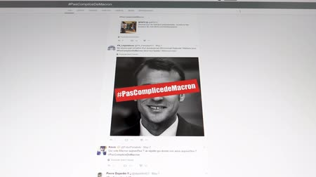 hashtag : Paris France - Circa 2017: Anti Emmanuel Macron Presidency tweets on the anonymous Tweeter profiles with diverse bad and discriminatory messages during Presidential Elections in France Stock Footage