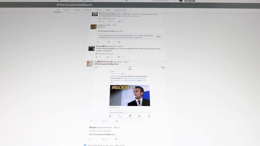 french president : Paris France - Circa 2017: Anti Emmanuel Macron Presidency tweets on the anonymous Tweeter profiles with diverse bad and discriminatory messages during Presidential Elections in France Stock Footage