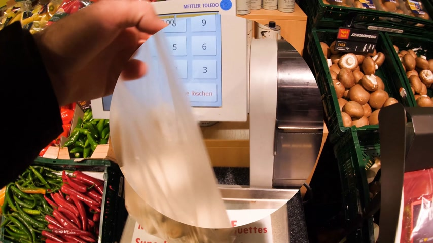sklep spożywczy : FRANKFURT, GERMANY - CIRCA 2017: Center loupe view of actions take by Male point of view at supermarket shopping for vegetables and fruits using electronic scale to weigh the mushrooms then put them in shopping cart