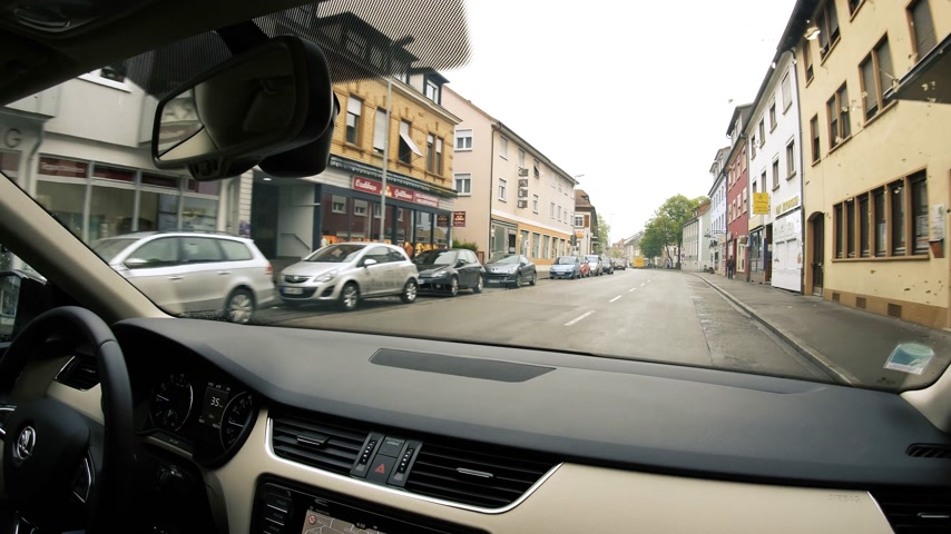 thoroughfare : KEHL, GERMANY - CIRCA 2017: Driving in German city of Kehl passenger point of view central city street small German town Stock Footage
