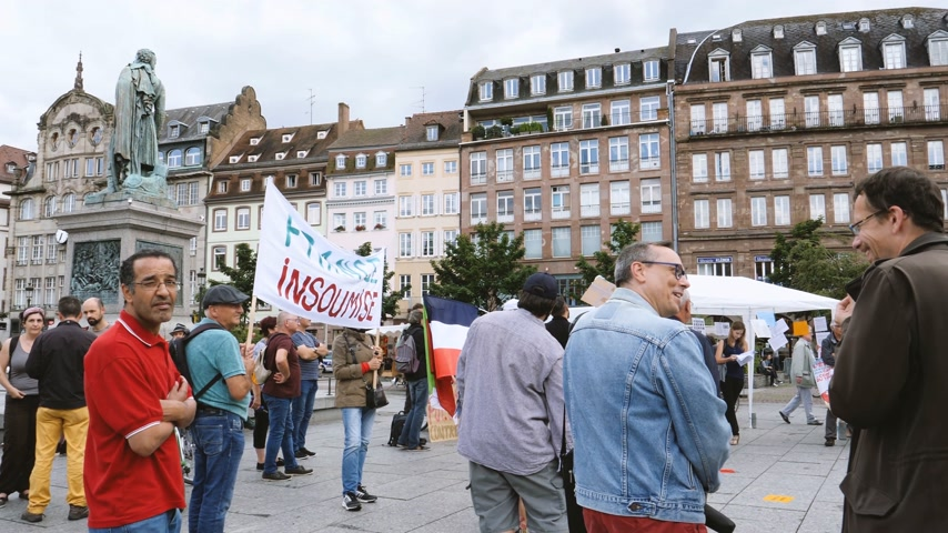 socialist party : STRASBOURG, FRANCE - JUL 12, 2017: Protesters in French city as Melenchon called for day of protest against Macron government spending cuts and pro-business tax and labor reforms Stock Footage