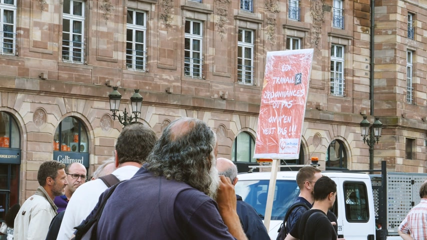 téma : STRASBOURG, FRANCE - JUL 12, 2017: Large crowd of protesters in city as Melenchon called for day of protest against Macron government spending cuts and pro-business tax and labor reforms