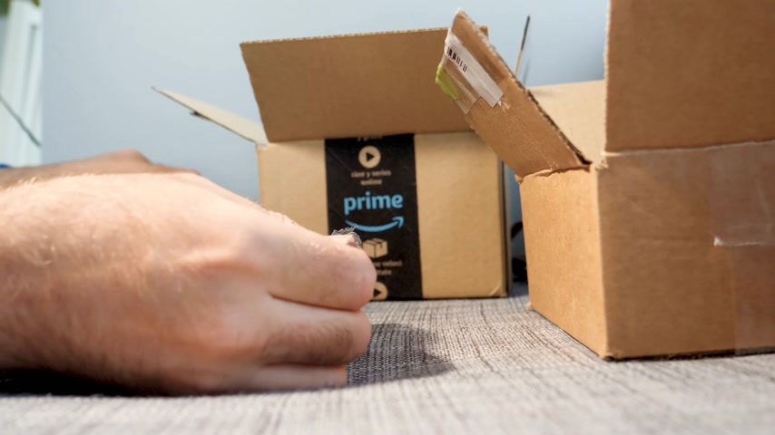 spona : PARIS, FRANCE - CIRCA 2017: Amazon Prime Member unboxing un packing the plastic film Amazon Shopping containing 8tb Western Digital Gold datacenter drive comparing the specification