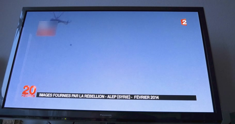 isis : PARIS, FRANCE - APR 20, 2015: Interview of Syrian President Bashar al-Assad to David Pujadas from France 2 TV with images from Alep Bombing (time-lapse fast motion) Stock Footage