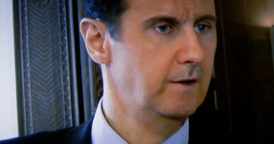 french president : PARIS, FRANCE - APR 20, 2015: Interview of Syrian President Bashar al-Assad to David Pujadas from France TV on TV screen in living room on evening news special edition - tilt down to tv sign Stock Footage