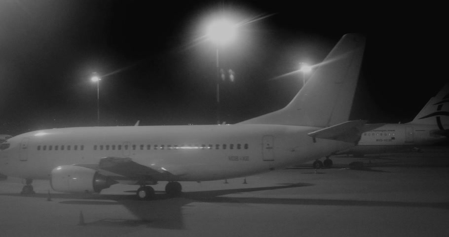 взлетно посадочная полоса : ATHENS, GREECE - CIRCA 2017: Fog night motion at airport tarmac at night motion at the Athens international Airport with multiple Boeing and Airbus aircraft from Aegean Airlines black and white
