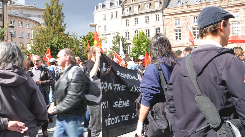 emmanuel macron : STRASBOURG, FRANCE - SEPT 12, 2017: Young people with placard at political march during a French Nationwide day of protest against the labor reform proposed by Emmanuel Macron Government Stock Footage