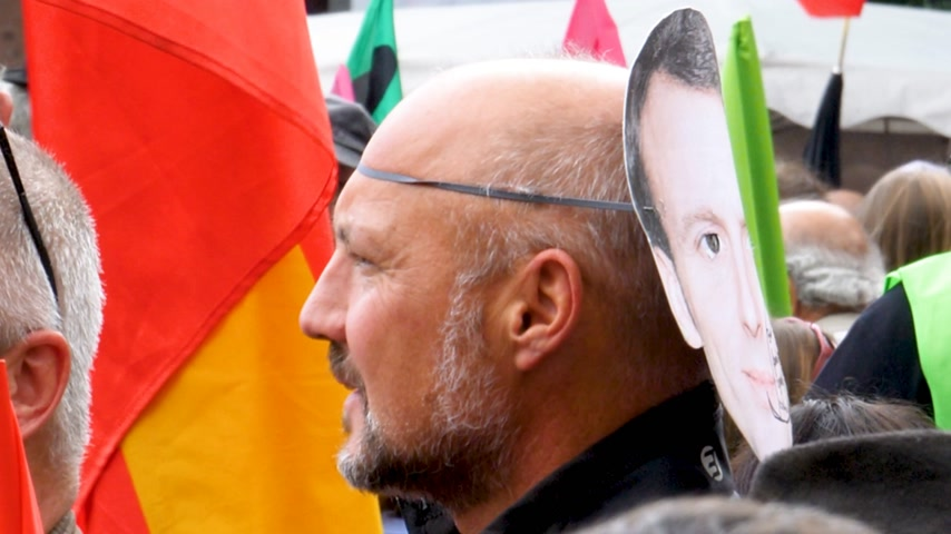 nationwide protest : STRASBOURG, FRANCE - SEPT 12, 2017: Protester wearing Emmanuel Macron mask at political march during a French Nationwide day of protest against the labor reform proposed by Emmanuel Macron Government