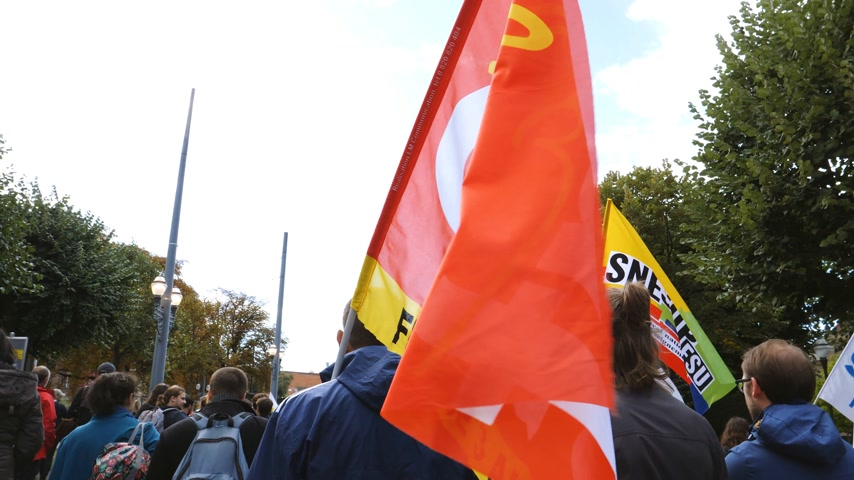 emmanuel macron : STRASBOURG, FRANCE - SEPT 12, 2017: General Confederation of Labour flags at political march during a French Nationwide day of protest against the labor reform proposed by Emmanuel Macron Government