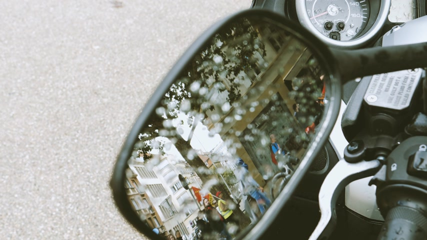 andar : STRASBOURG, FRANCE - SEPT 12, 2017: Reflections in motorcycle mirror of walking with smoke grenade protest against labor reform proposed Emmanuel Macron