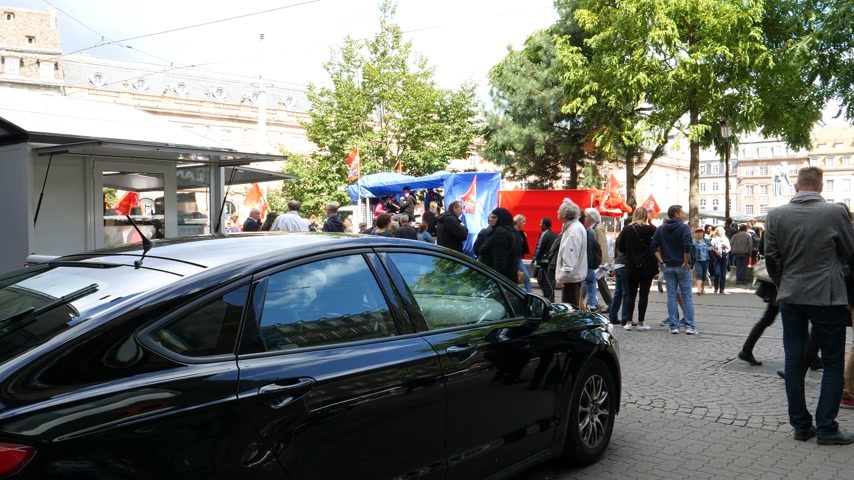 nationwide : STRASBOURG, FRANCE - SEPT 12, 2017: French Police officers surveillance political march during a French Nationwide day of protest - General Directorate for Internal Security officers in car