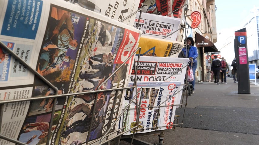 mass shooting : PARIS, FRANCE - OCT 3, 2017: Dutch algemeen dagblad newspaper with socking title and photo at press kiosk about the 2017 Las Vegas Strip shooting in United States with about 60 fatalities and 527 injuries