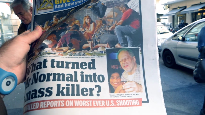 usa today : PARIS, FRANCE - OCT 3, 2017: Man reading USA TODAY newspaper with portrait of Stephen Paddock 2017 Las Vegas Strip shooting in United States with about 60 kills slow motion Stock Footage