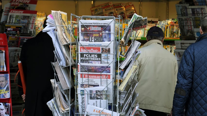 mass shooting : PARIS, FRANCE - OCT 3, 2017: People Seniors buying international newspapers at Kiosk with socking title photos at about the 2017 Las Vegas Strip shooting in United States with about 60 fatalities and 527 injuries