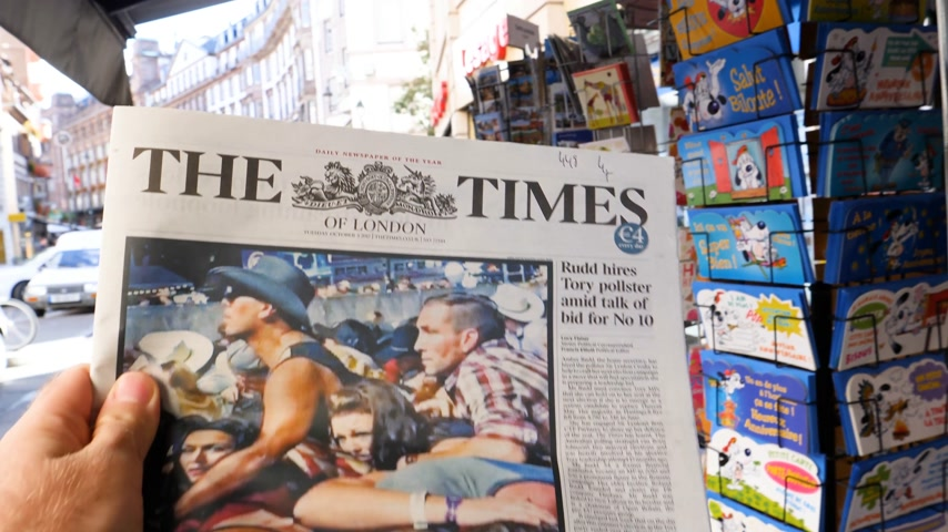 gunman : PARIS, FRANCE - OCT 3, 2017: Man buying The Times newspaper with socking title and photo at press kiosk about the 2017 Las Vegas Strip shooting in United States with about 60 fatalities and 527 injuries Stock Footage