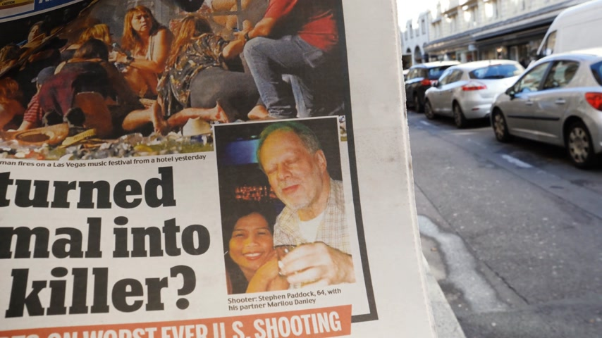 mass shooting : PARIS, FRANCE - OCT 3 2017: Man buying Daily Daily newspaper with Photo of Stephen Paddock press kiosk about the 2017 Las Vegas Strip shooting in United States with about 60 fatalities and 527 injuries