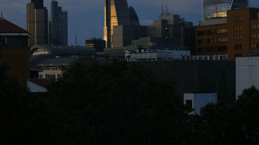 machado : Drone view in London - tilt to the city of London financial district skyline with iconic Gherkin 30 St Mary Axe , Walkie Talkie building, working late concept overtime in Business district Vídeos