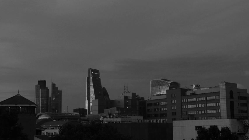 talkie walkie : Drone view of defocusing London still of the city of London financial district skyline with iconic Gherkin 30 St Mary Axe , Walkie Talkie building, working late concept overtime in Business district black and white