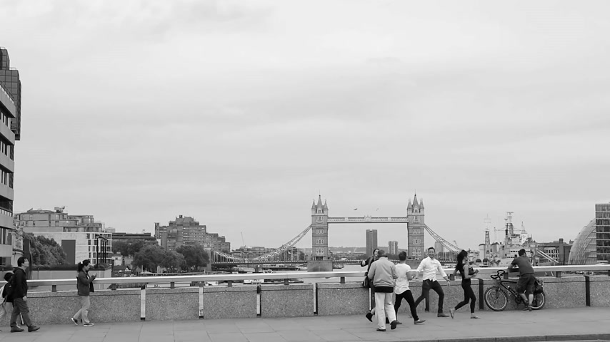 memories photos : LONDON, UNITED KINGDOM - CIRCA 2016: People visiting London and taking tourist photos with Tower Bridge in the background, the symbol of London and England black and white