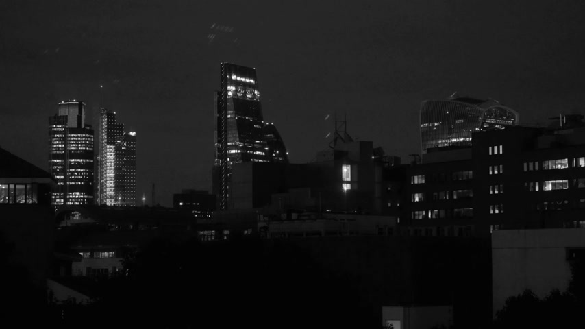machado : Black and white still drone beautiful cinematic London still of the city of London financial district skyline iconic Gherkin 30 St Mary Axe , Walkie Talkie building, working late concept overtime in Business district