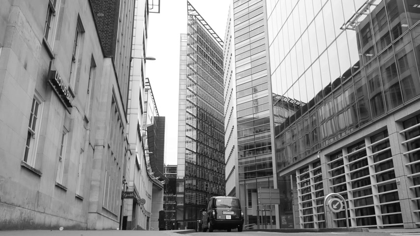 hackney carriage : London, United Kingdom - Circa 2017 View from below of New Fetter Ln lane street big office skyscraper buildings London traditional taxi and Vauxhall Motors car driving fast on a working day cinematic Stock Footage