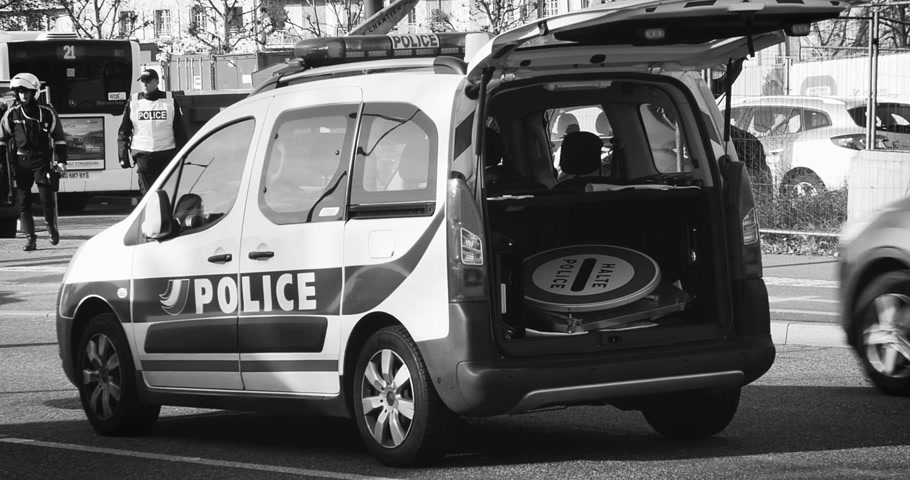 je suis charlie : STRASBOURG, FRANCE - NOV 14 2015: French Police car  and officers checking vehicles zoom out vehicle on the border between Strasbourg and Kehl Germany, as a security measure after attacks in Paris