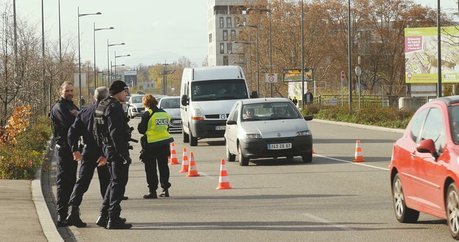 je suis charlie : STRASBOURG, FRANCE - NOV 14 2015: French Police car  and officers checking vehicles on the border between Strasbourg and Kehl Germany, as a security measure in the wake of attacks in Paris