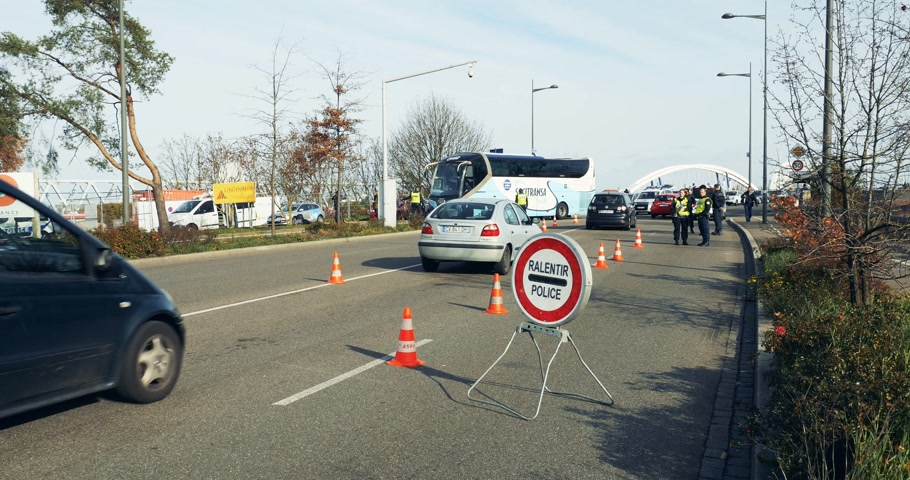 je suis charlie : STRASBOURG, FRANCE - NOV 14 2015: slow down sign with French German Police checking vehicles on the border between Strasbourg and Kehl Germany, as a security measure in the wake of attacks in Paris Stock Footage