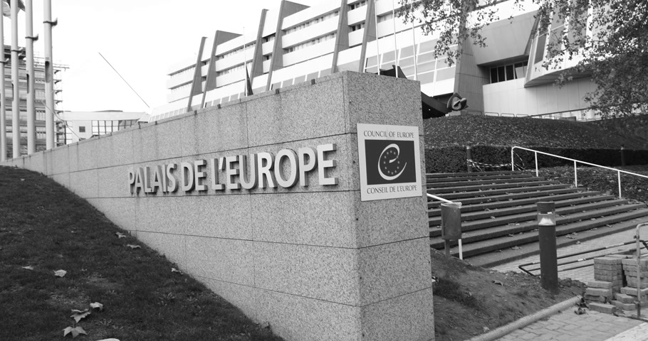 saygı : STRASBOURG, FRANCE - 14 Nov 2015: Workers of Council of Europe put all European Union Flags at half-mast in front of Council of Europe following terrorist attack in Paris at Bataclan black and white