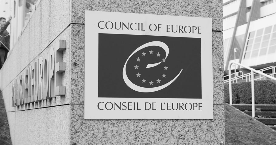 tüm : STRASBOURG, FRANCE - 14 Nov 2015: Workers of Council of Europe put all European Union Flags at half-mast in front of Council of Europe following terrorist attack in Paris at Bataclan black and white