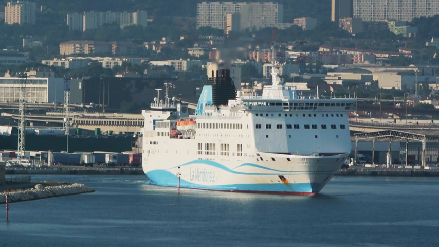 visto : Marseille, France - Circa 2017: Girolata, large ferry ship owned by La Meridionale exits Marseille exits Marseille-Fos Port with Destination Corsica island. Large ferry transporting people, cars, trucks time-lapse, fast motion