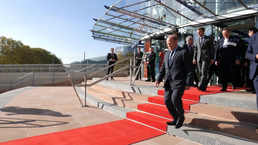 european court of human rights : STRASBOURG, FRANCE - OCT 31, 2017: Time lapse of the exit on the red carpet installation at European Court of Human Rights for the Emmanuel Macron French President official visit Stock Footage
