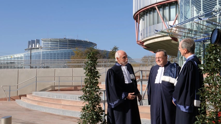 european court of human rights : STRASBOURG, FRANCE - OCT 31, 2017: European Court of Human Rights president Guido Raimondi (c) next to French judge Andre Potocki (l) and the registrar Roderick Liddell (r), Emmanuel Macron visit