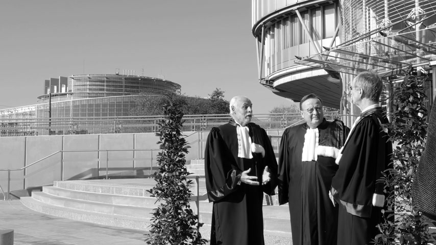 french president : STRASBOURG, FRANCE - OCT 31, 2017: European Court of Human Rights president Guido Raimondi (c) next to French judge Andre Potocki (l) and the registrar Roderick Liddell (r), Emmanuel Macron visit