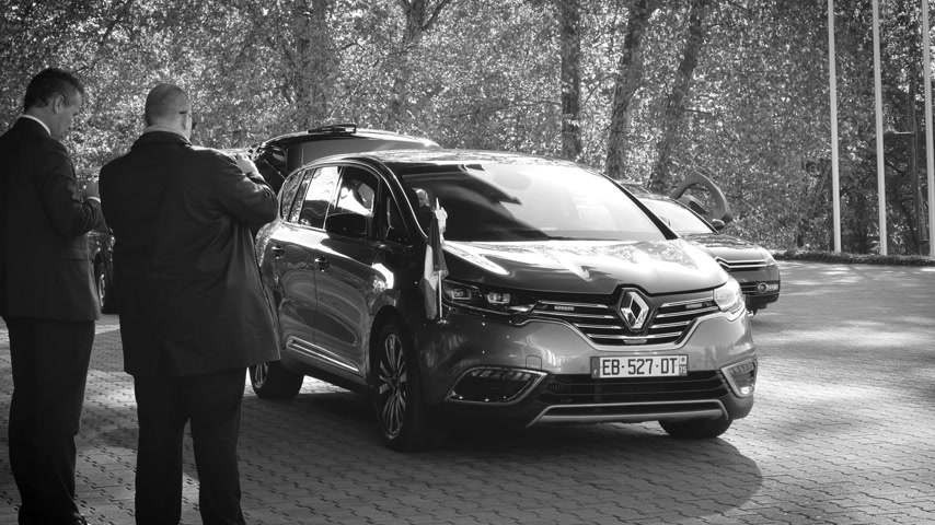 european court of human rights : STRASBOURG, FRANCE - OCT 31, 2017: Renault Espace Initiale van car, official transportation of Emmanuel Macron French President parked in front of Council of Europe during official visit b&w
