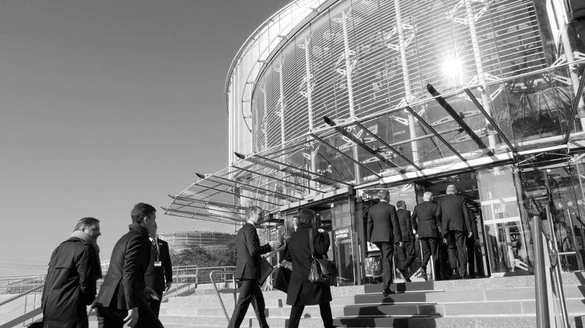 união : STRASBOURG, FRANCE - OCT 31, 2017: Diplomats and delegations on red carpet entering the European Court of human Rights building in Strasbourg during Emmanuel Macron French President visit b&w